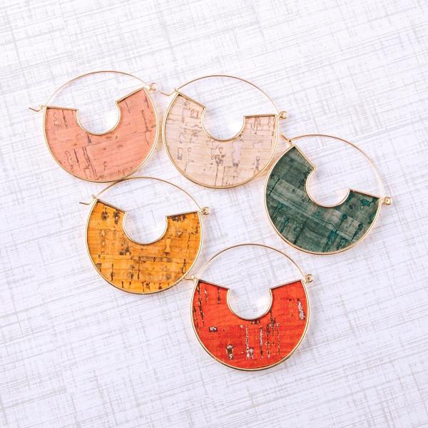 """Metal hoop earrings featuring cork inspired details. Approximately 2"""" in diameter."""