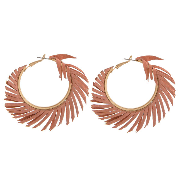 "Feather inspired hoop earrings. Approximately 2"" in diameter."