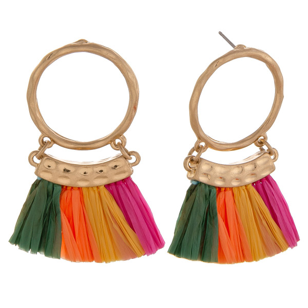 "Circular drop earrings featuring multi tassels and gold accents. Approximately 2"" in length."