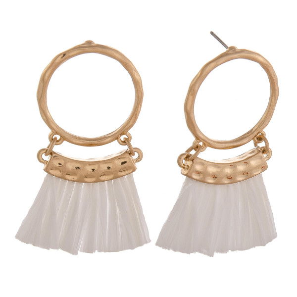 "Circular drop earrings featuring white tassels and gold accents. Approximately 2"" in length."