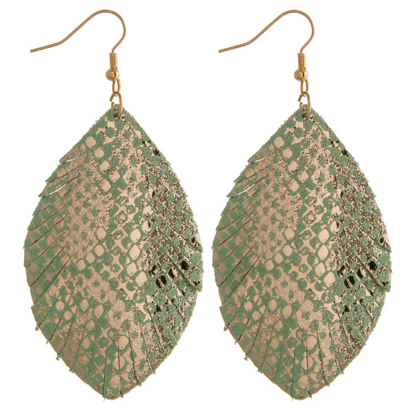 """Faux leather feather inspired earrings featuring gold metallic animal print details. Approximately 2.5"""" in length."""