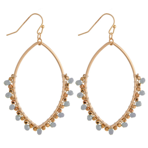 """Long metal earrings featuring beaded details and gold accents. Approximately 2"""" in length."""