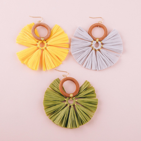 "Large raffia tassel earrings featuring a circular wood accent. Approximately 3"" in diameter."