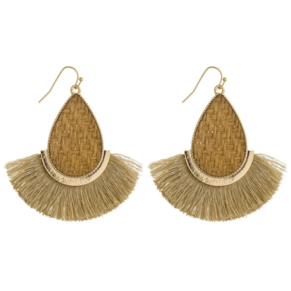 "Rattan woven teardrop earrings featuring tassel details and gold metal accents. Approximately 2.5"" in length."