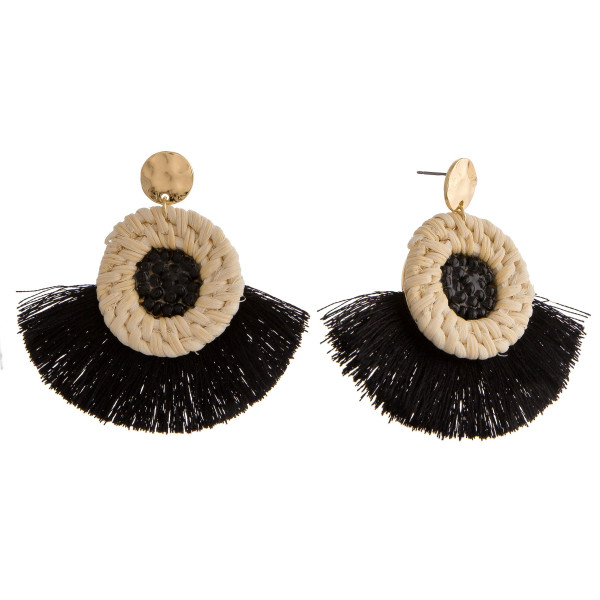 "Rattan woven circular earrings featuring a beaded center detail and tassel accents with a stud post. Approximately 2"" in length."