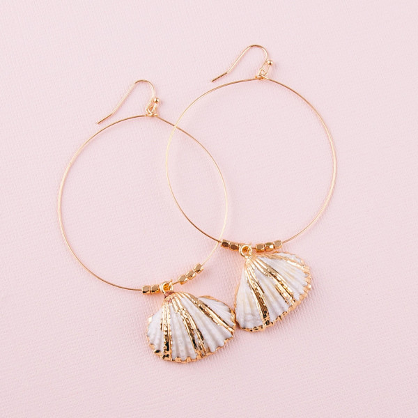 "Large dainty circular earrings featuring a seashell detail and gold bead accents. Approximately 3"" in length."