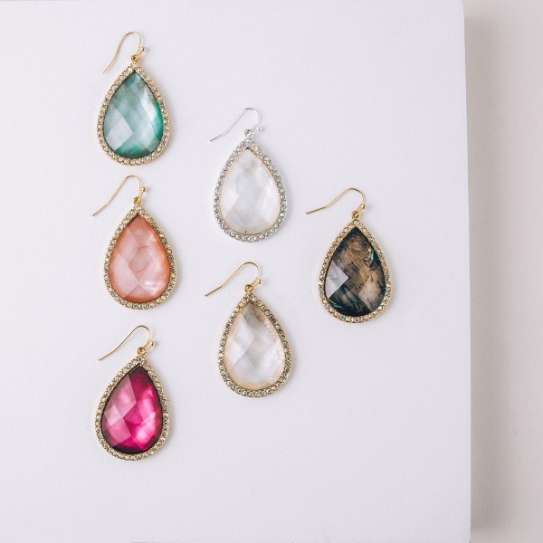 "Teardrop earrings featuring a pink natural stone and rhinestone details. Approximately 1.5"" in length."