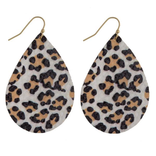 "Faux leather teardrop earrings featuring leopard print. Approximately 2"" in length."
