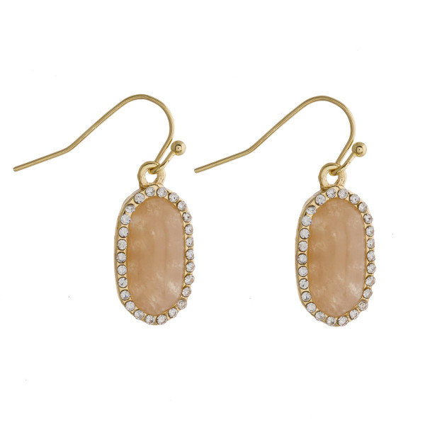 "Drop earrings featuring a orange natural stone and cubic zirconia details. Approximately .5"" in length."