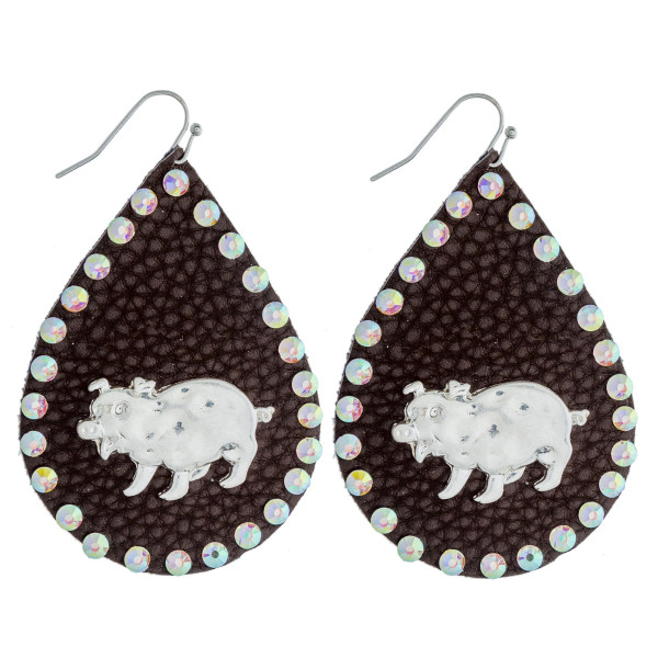 """Faux leather teardrop earrings featuring a metal pig detail and multicolor rhinestone accents. Approximately 2.5"""" in length."""