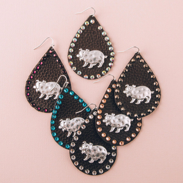"""Faux leather teardrop earrings featuring a metal pig detail and peach rhinestone accents. Approximately 2.5"""" in length."""