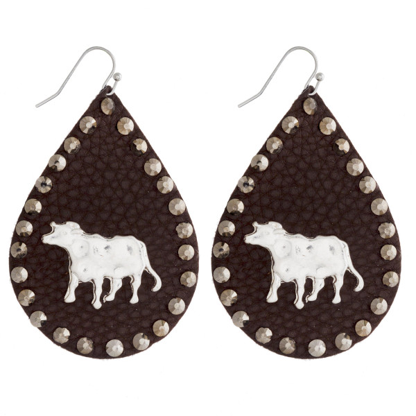 """Faux leather teardrop earrings featuring a metal cow detail and brown rhinestone accents. Approximately 2.5"""" in length."""
