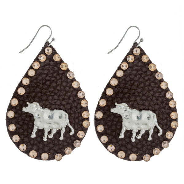 """Faux leather teardrop earrings featuring a metal cow detail and peach rhinestone accents. Approximately 2.5"""" in length."""