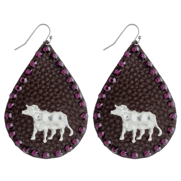 """Faux leather teardrop earrings featuring a metal cow detail and purple rhinestone accents. Approximately 2.5"""" in length."""