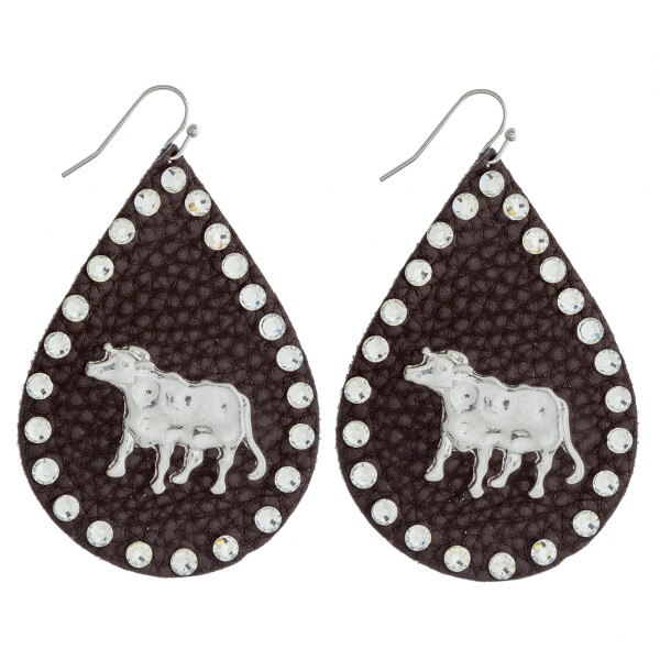 """Faux leather teardrop earrings featuring a metal cow detail and silver rhinestone accents. Approximately 2.5"""" in length."""