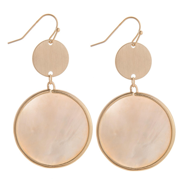 """Long ivory mother of pearl circular earrings with brass detail. Measures approximately 2"""" long."""