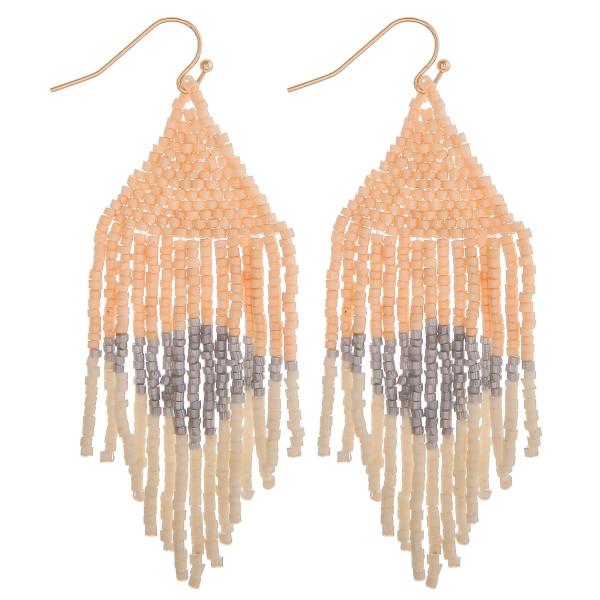 "Long natural mix boho beaded earrings. Measures approximately 2.75"" long."