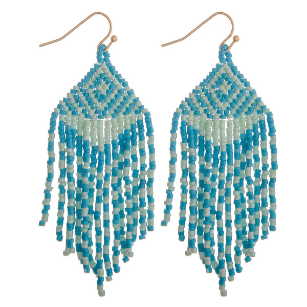 "Long turquoise mix boho beaded earrings. Measures approximately 2.75"" long."