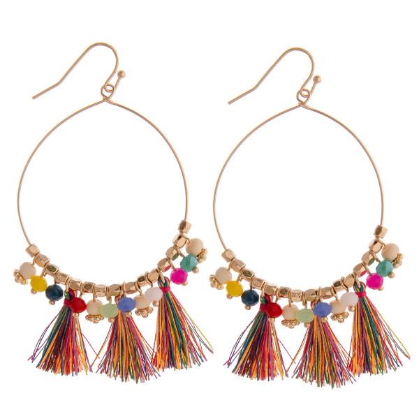 "Long mutli colored beaded circular earrings featuring tassel details. Measures approximately 2.75"" long."