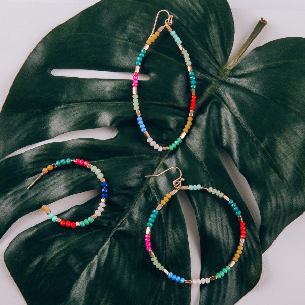 """Short hoop earrings with multi colored beaded detail. Measures approximately 1.5"""" long."""