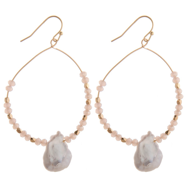 "Long baroque pearl circular earrings featuring blush colored beads. Measure approximately 2"" long."