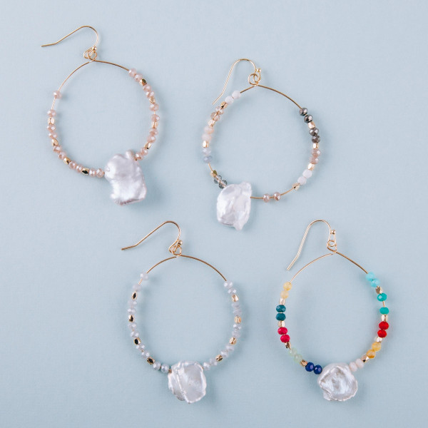 "Long baroque pearl circular earrings featuring light blue beads. Measure approximately 2"" long."