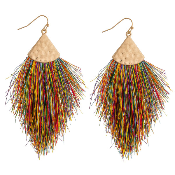 "Long drop earrings featuring tassel details and gold metal accents. Approximately 3.5"" in length."