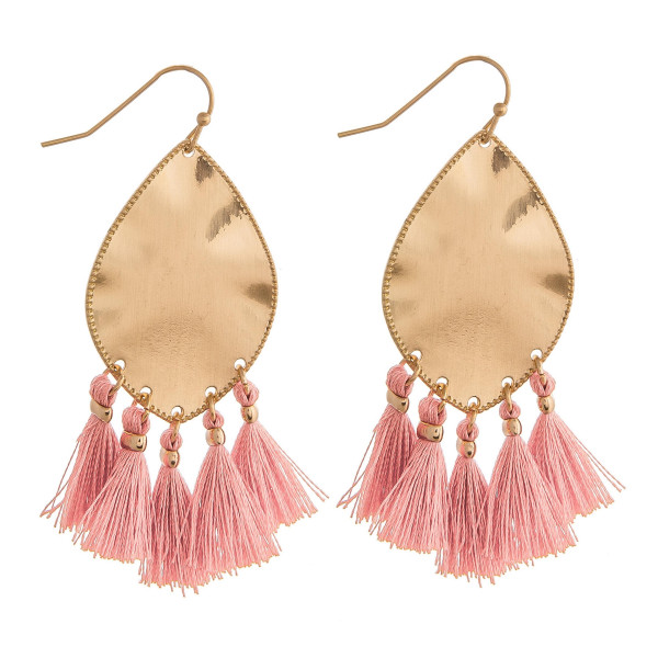 "Metal plated drop earrings featuring blush tassel accents. Approximately 2"" in length."