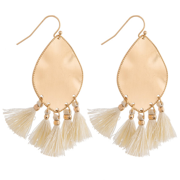 """Metal plated drop earrings featuring ivory tassel accents. Approximately 2"""" in length."""