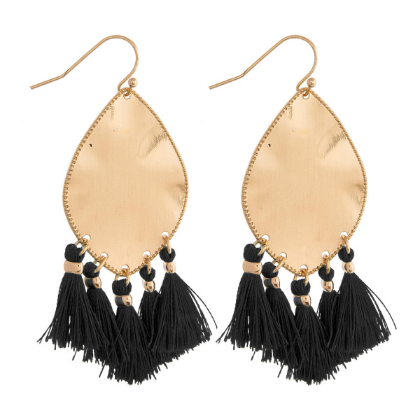 "Metal plated drop earrings featuring black tassel accents. Approximately 2"" in length."