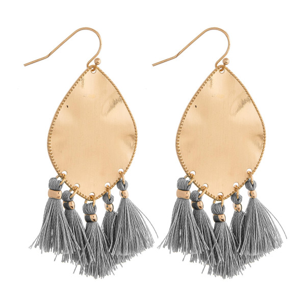 "Metal plated drop earrings featuring grey tassel accents. Approximately 2"" in length."