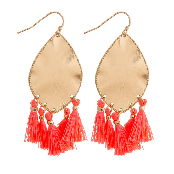 "Metal plated drop earrings featuring neon pink tassel accents. Approximately 2"" in length."