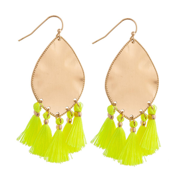 "Metal plated drop earrings featuring neon yellow tassel accents. Approximately 2"" in length."