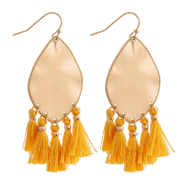 "Metal plated drop earrings featuring yellow tassel accents. Approximately 2"" in length."