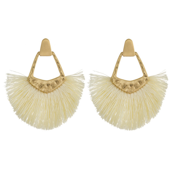 "Gold metal earrings featuring tassel accents and a stud post. Approximately 2"" in length."