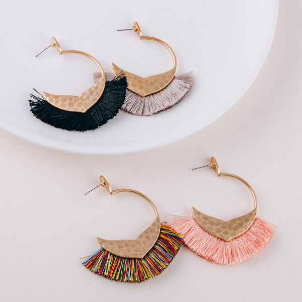 "Open hoop metal earrings featuring a mermaid tale detail and tassel accents with a stud post. Approximately 2"" in length."