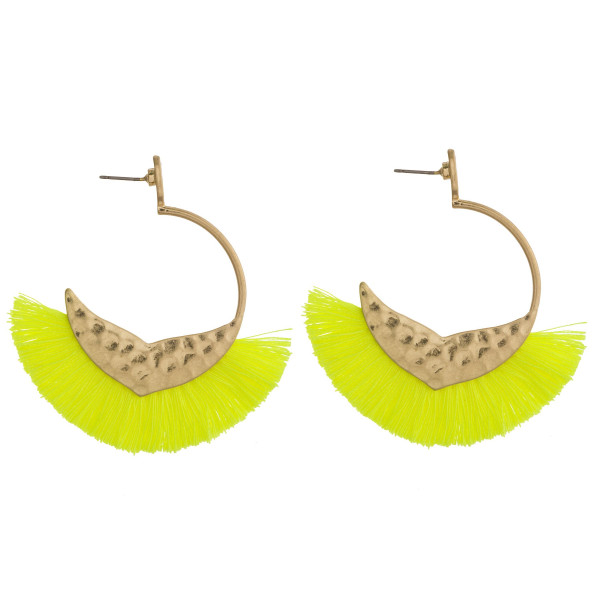 "Open hoop metal earrings featuring a mermaid tale detail and neon tassel accents with a stud post. Approximately 2"" in length."