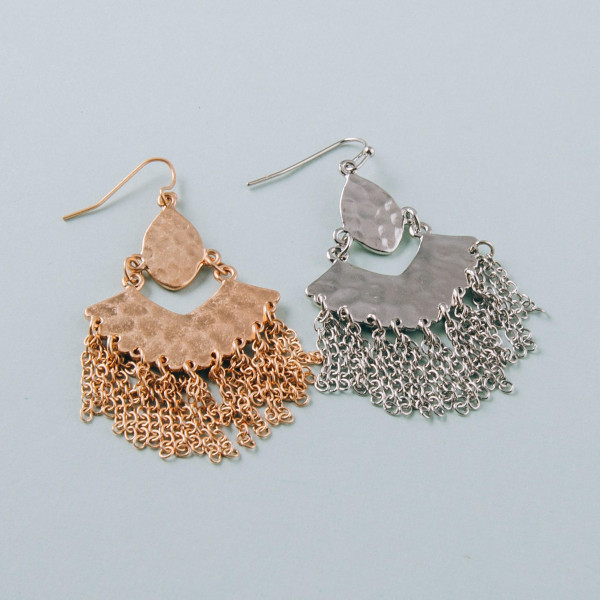"Long metal plated drop earrings featuring metal accents and tassel details. Approximately 1.5"" in length."