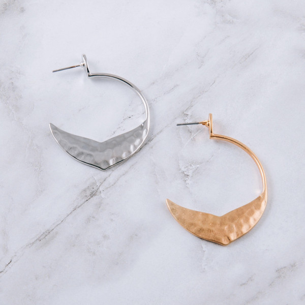 "Open hoop earrings featuring a mermaid tale inspired detail and a stud post. Approximately 1.5"" in diameter."