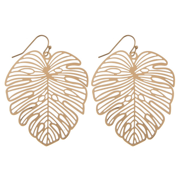 """Gold earrings featuring a leaf pattern. Approximately 2"""" in length."""