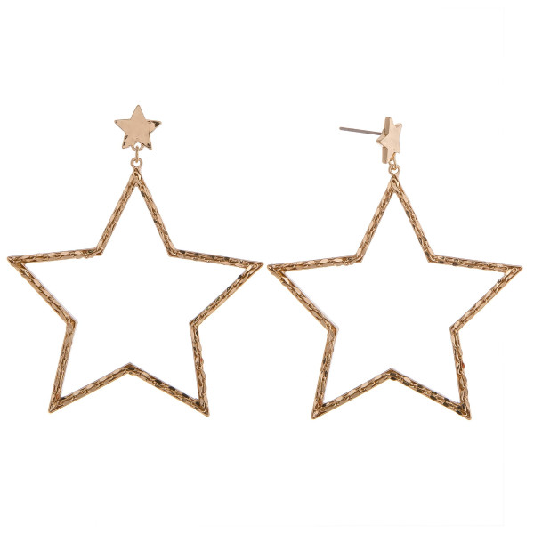 Gold star drop earrings featuring a braided texture.
