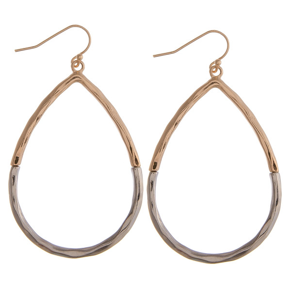 """Two tone gold and silver teardrop earrings featuring a wavy texture. Approximately 1.5"""" in diameter."""