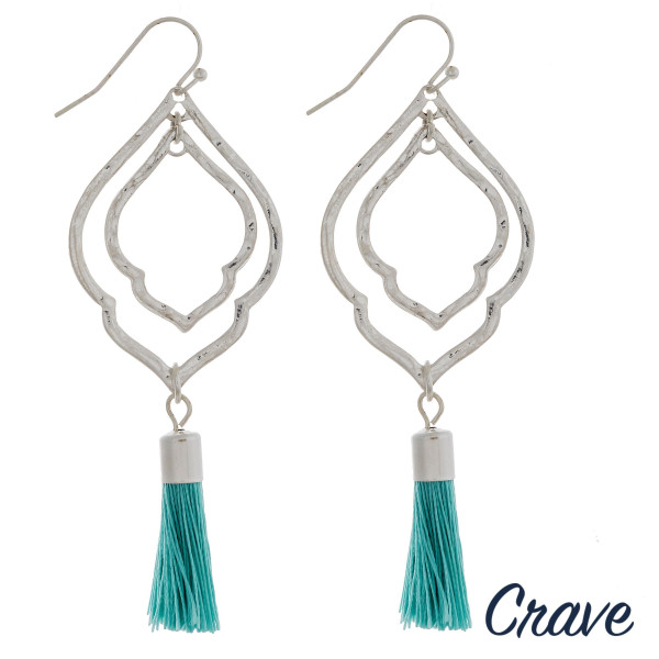 """Drop metal earrings featuring a hammered texture and aqua fanned tassel accents. Approximately 2.75"""" in length."""
