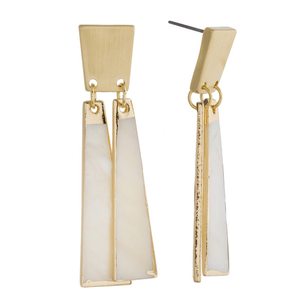 "Long brass ivory mother of pearl earrings. Approximately 2"" in length."