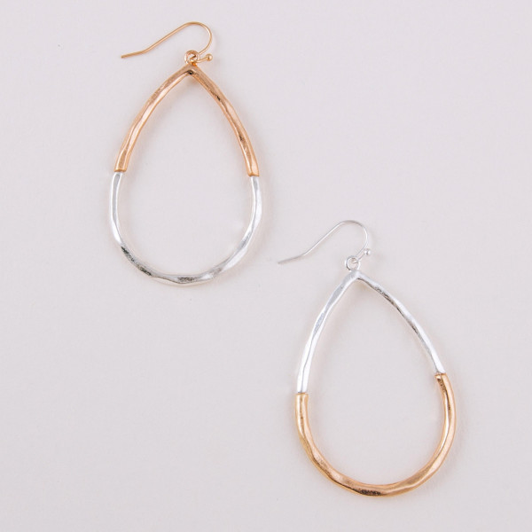 "Long teardrop earrings featuring two tone metal details. Approximately 2"" in length."