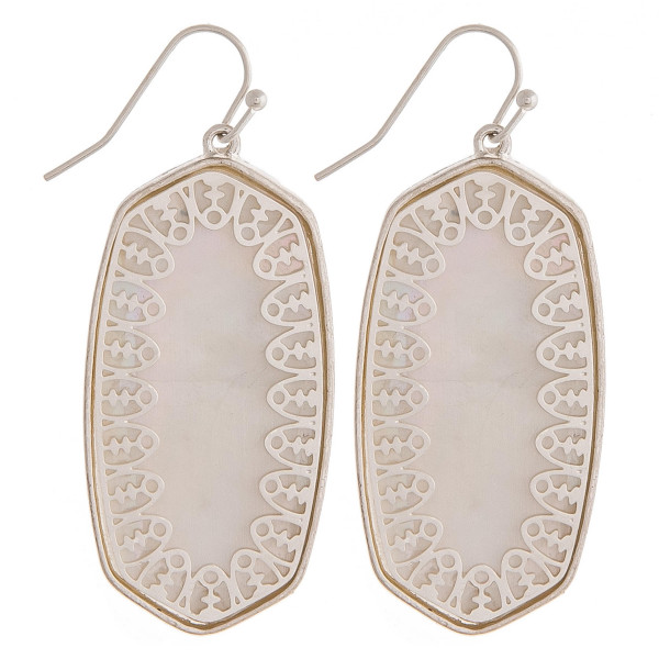 "Long metal earrings featuring mother of pearl inspired details and silver accents. Approximately 1.5"" in length."