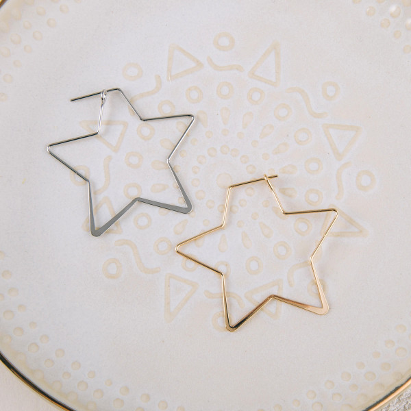 "Dainty metal star earrings. Approximately 1.5"" in length."