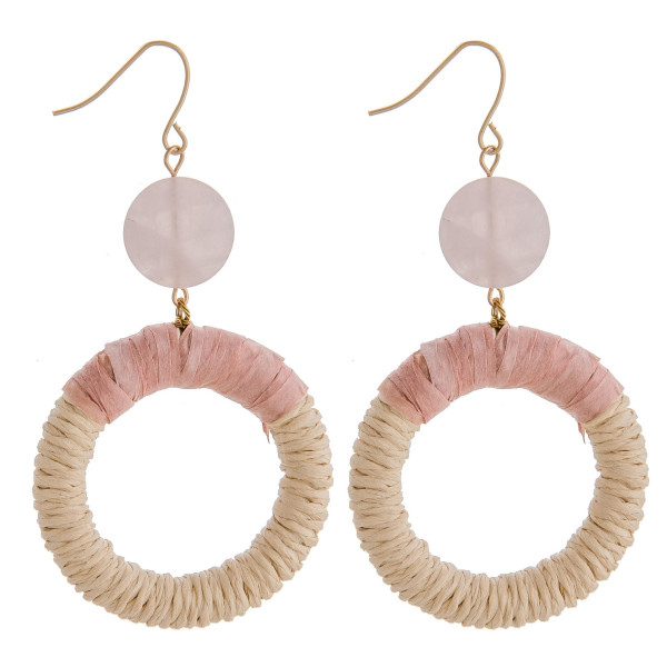 """Rattan woven circular earrings featuring raffia wrapped details and a natural stone accent. Approximately 2.5"""" in length."""