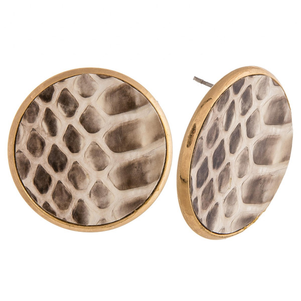 "Genuine leather stud earrings featuring a snakeskin detail. Approximately 1"" in diameter."