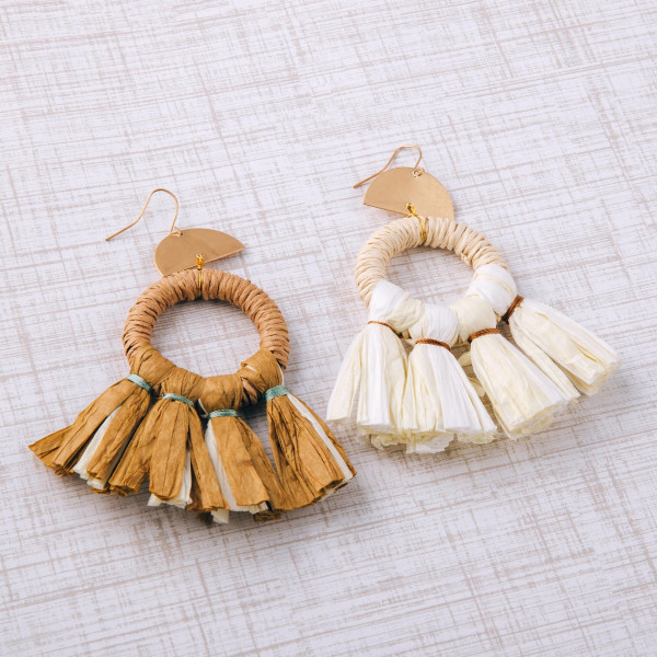 """Rattan woven circular earrings featuring raffia wrapped details and tassel accents. Approximately 3.5"""" in length."""